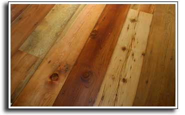 A reclaimed wood floor made from weathered barn siding, sanded and oil coated.